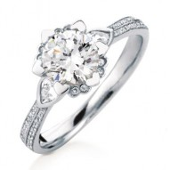 Iris Round Halo with Pear Side Stones and Pave Engagement